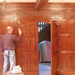 Polishing work in progress on a panelled partition wall