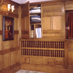 Radiator housing with linen cupboard integrated into panelling