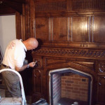 Skilful hands add the finishing touches to a Gothic style fireplace in Worcestershire