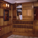 Storage cupboards concealed in the panelled walls of a Henley home