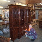 Gothic glazed bookcase with polishing being completed